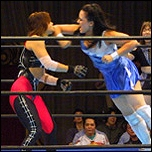 Cheerleader Melissa connects with a hard forearm in action from her debut music video...available for download this weekend from ClickWrestle.com and G.L.O.R.Y. Wrestling.