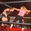 Nattie Neidhart uses a handful of hair to steady Sara del Rey for a punch to the head during their rugged singles match, which was won by del Rey.