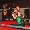 Lacey looks positively demonic as she pulls back on the arms of MsChif while jamming her knee into her opponent's spine. Rain is mouthing off to the fans in the background. Lacey and Rain defeated MsChif and Cheerleader Melissa in a 15-minute tag match.