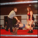 If looks could kill, the ref would be dead meat as Lexie Fyfe fixes him with an evil eye when she's told to stop abusing Lorelei Lee.